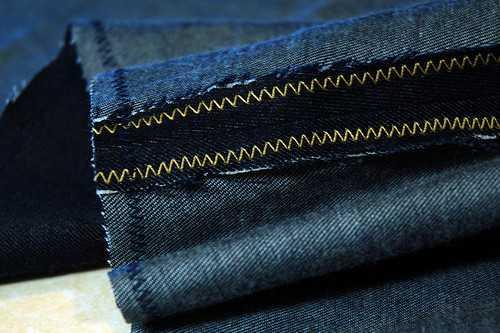 A zig-zag stitch is used to prevent the SA of the denim from fraying